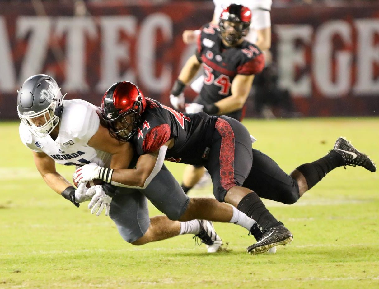 Senior linebacker Kyahva Tezino makes a tackle in the Aztecs' 17-13 loss to Nevada on Nov. 9 at SDCCU Stadium. Tezino finished the game recording nine total tackles, 2.5 tackles for a loss and a sack.