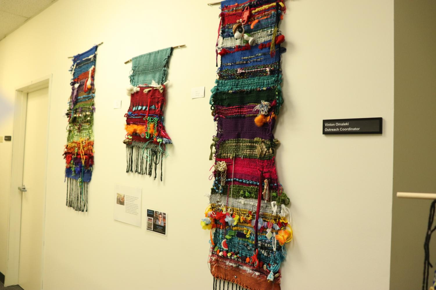 Alex Nichols makes woven wall art along with scarves, bowls and ornaments.