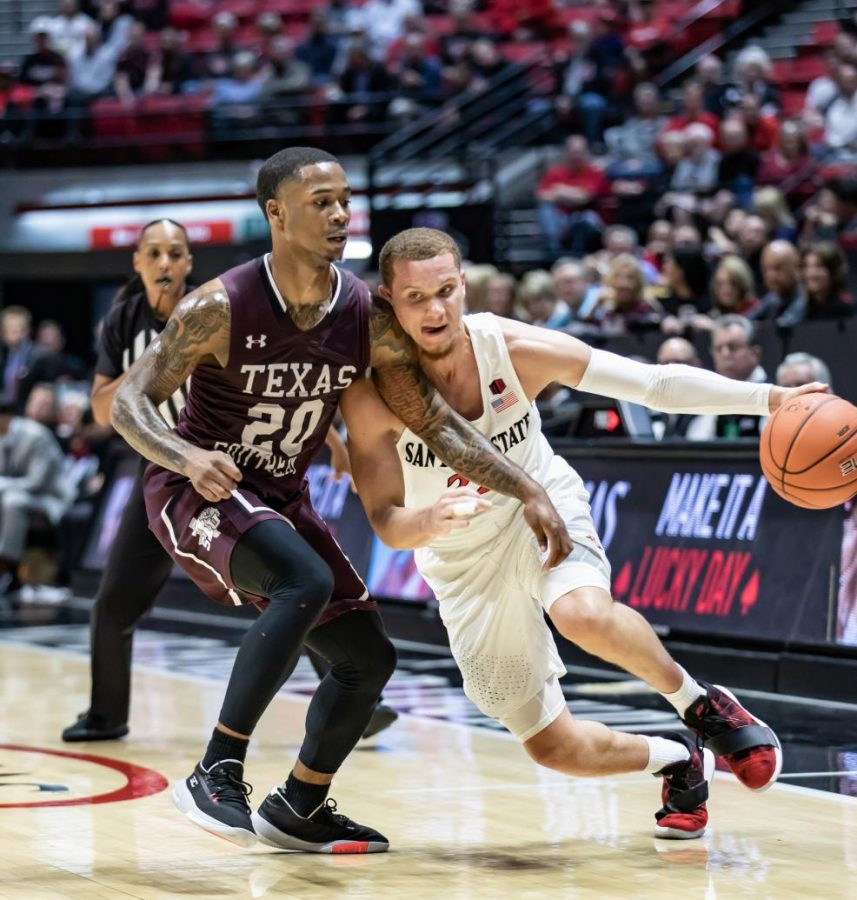 Junior guard Malachi Flynn attempts to dribble past the Texas Southern defender during the Aztecs' 77-42 victory on Nov. 5 at Viejas Arena.