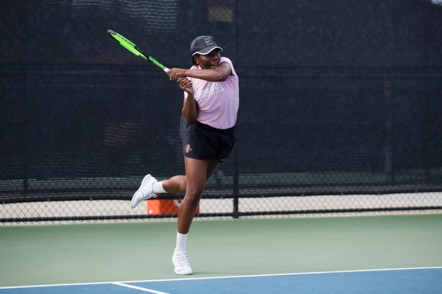 Junior Nnena Nadozie finishes her swing during the SDSU Fall Classic I from Sept. 27-29 at the Aztec Tennis Center.