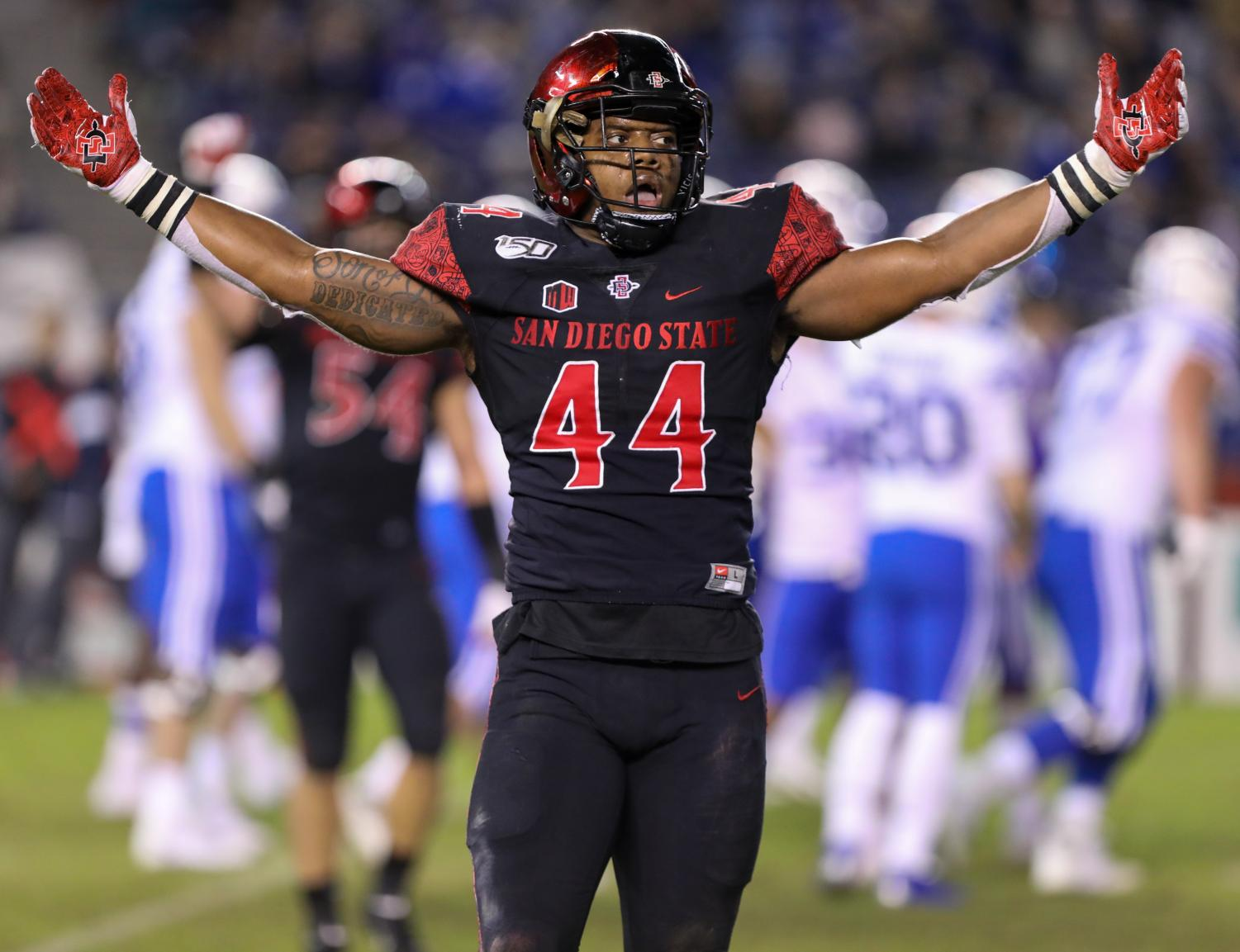 Senior linebacker Kyahva Tezino reacts after a play during the Aztecs' 13-3 victory over BYU on Nov. 30