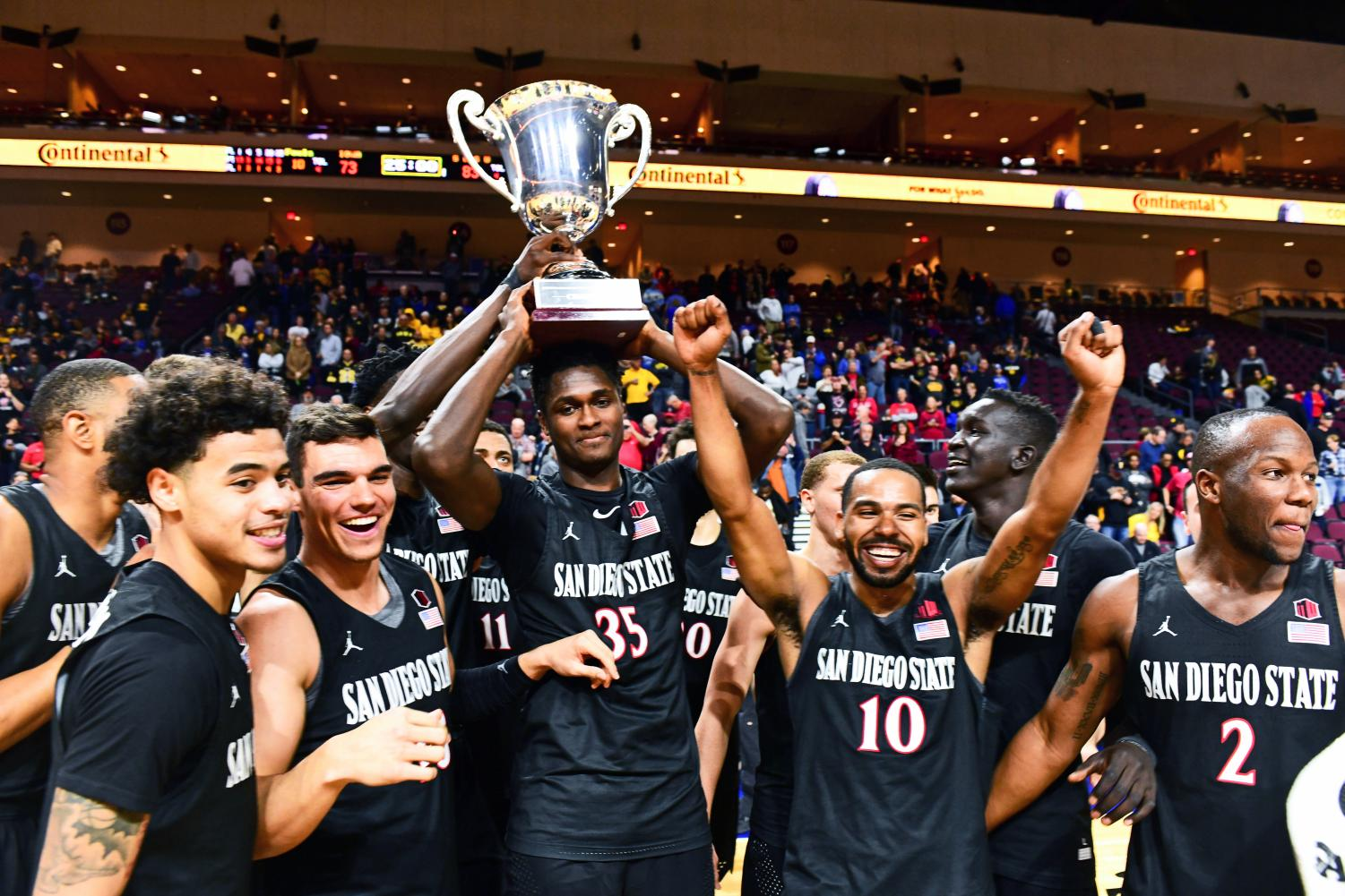 Sophomore forward Joel Mensah lifts up the first-place trophy after an 83–73 victory over the Iowa Hawkeyes in the Las Vegas Invitational at Orleans Arena.
