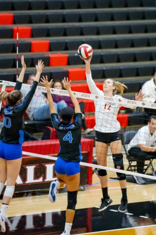 Then-junior outside hitter Erin Gillcrist gets the ball over the net in the Aztecs' 3-1 win over Air Force on Nov. 14, 2019 at Peterson Gym.