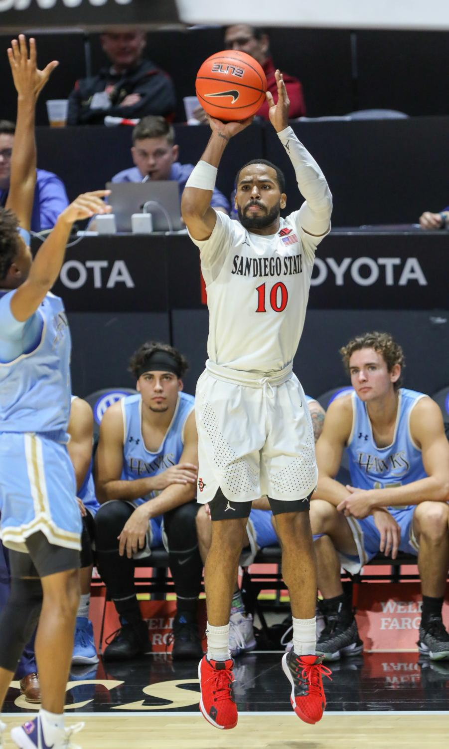Senior guard KJ Feagin shoots a 3-point jumper in the Aztecs' 92-48 win over San Diego Christian on Dec. 18 at Viejas Arena.