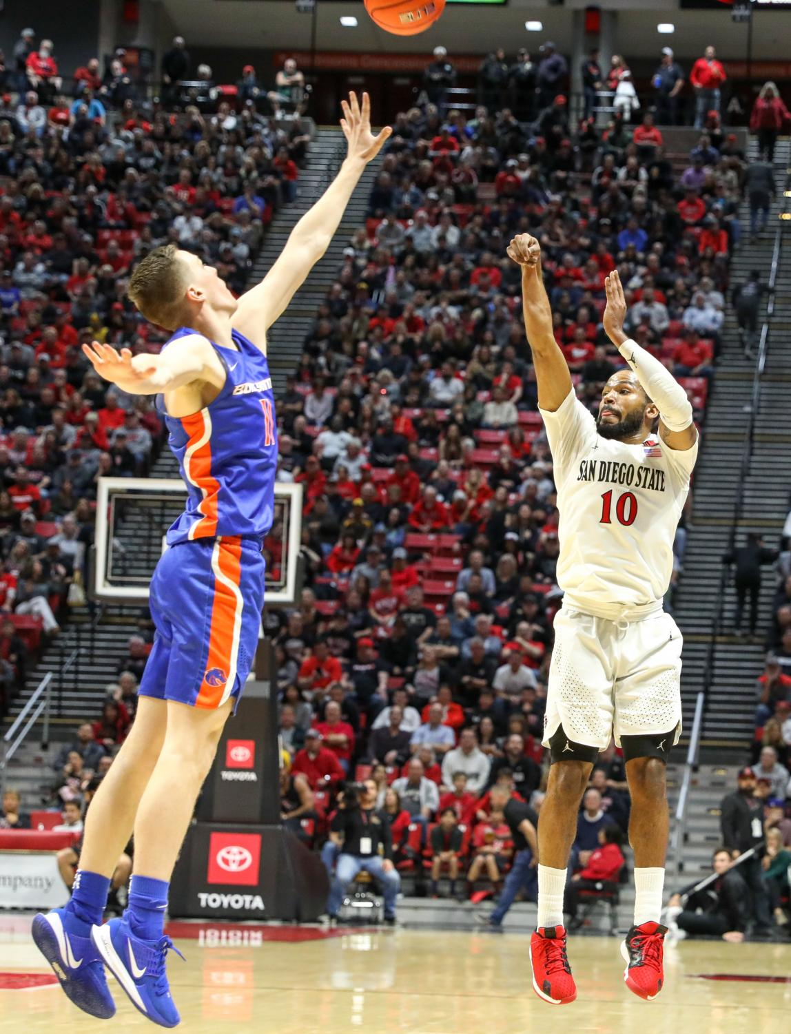 Senior guard KJ Feagin shoots over a Boise State defender during the Aztecs' 83-65 win on Jan. 11 at Viejas Arena.
