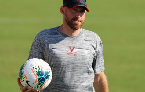 Ryan Hopkins was on a coaching staff at Virginia that made the national championship game in 2019.