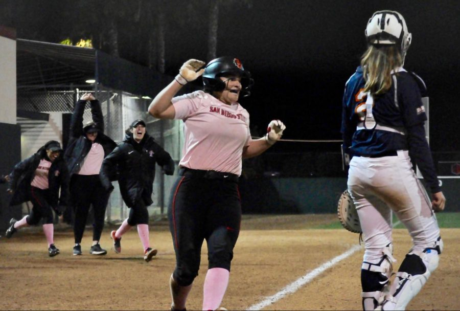 Junior+outfielder+Alexa+Schultz+celebrates+as+she+scored+the+walk-off+run+to+give+SDSU+the+3-2+victory+in+the+eighth+inning+against+Cal+State+Fullerton+on+Feb.+14+at+SDSU+Softball+Stadium.