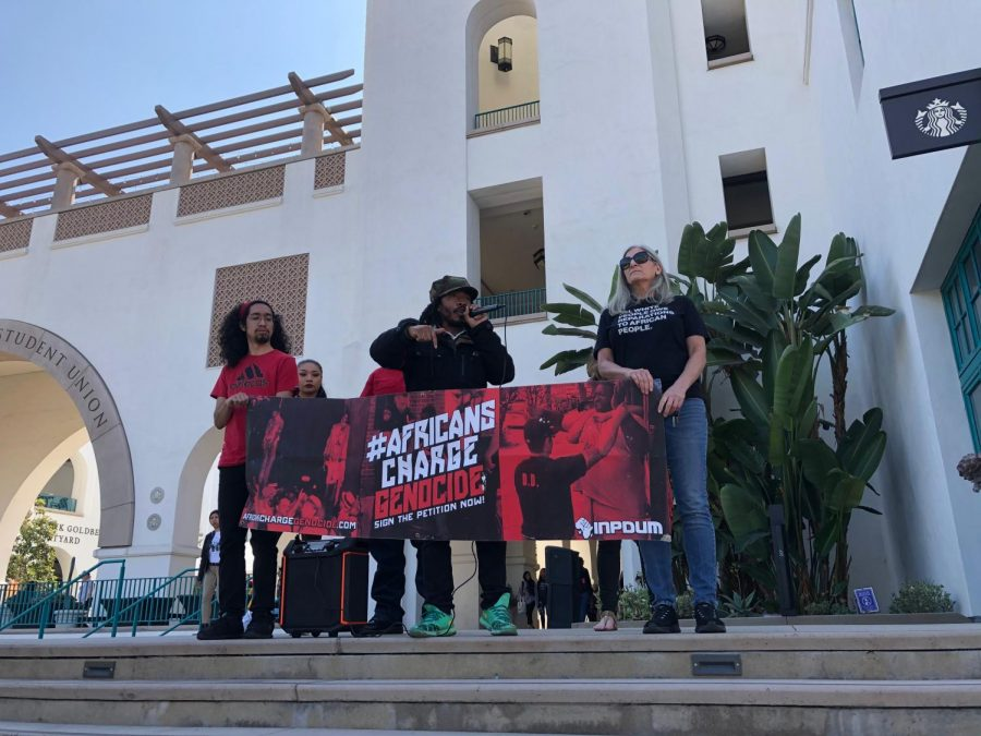 Students+and+faculty+representing+the+Africans+Charge+Genocide+group+protest+the+potential+ban+on+two+guest+speakers+accused+of+anti-Semitism.