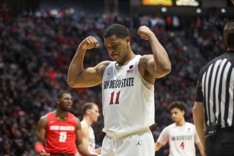 Junior forward Matt Mitchell flexes in celebration after a chance to complete a three-point play against New Mexico on Feb. 11 at Viejas Arena.