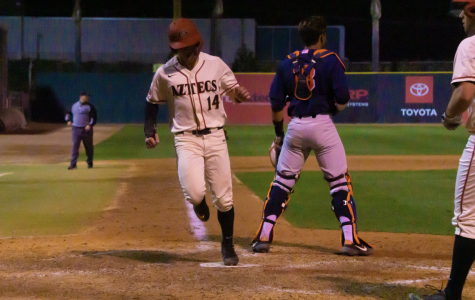 Senior outfielder Mike Jarvis scores during the Aztecs' 8-4 win over Cal State Fullerton on Feb. 18 at Tony Gwynn Stadium.