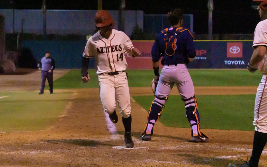 Senior+outfielder+Mike+Jarvis+scores+during+the+Aztecs%27+8-4+win+over+Cal+State+Fullerton+on+Feb.+18+at+Tony+Gwynn+Stadium.