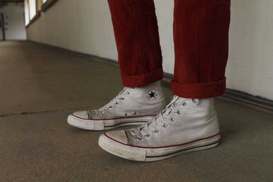 Converse are his go to shoes because they go with everything.