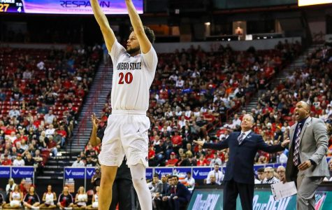 Junior guard Jordan Schakel attempts a 3-pointer during the Aztecs' 73-60 win over Air Force at Thomas and Mack Center on March 5. Air Force head coach Dave Pilipovich is visibly upset of Schakel taking that shot. Schakel had a team-high 17 points.