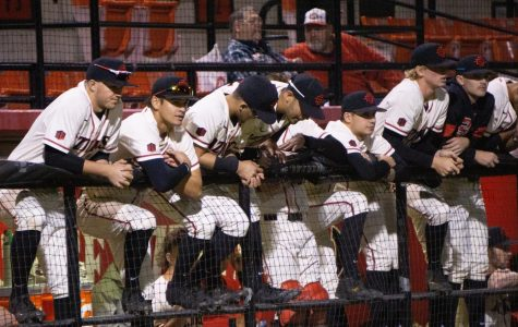 San Diego State baseball players look towards the field from the dugout during the Aztecs' 4-1 win over Iowa on Feb. 21 at Tony Gwynn Stadium.
