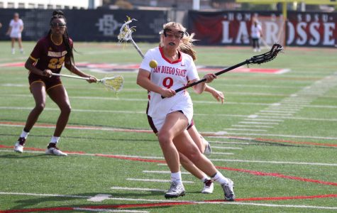 Senior midfielder Morgan Taylor attempts to secure possession of the ball during the Aztecs' 19-18 win over Arizona State on Feb. 20 at Aztec Lacrosse Field.