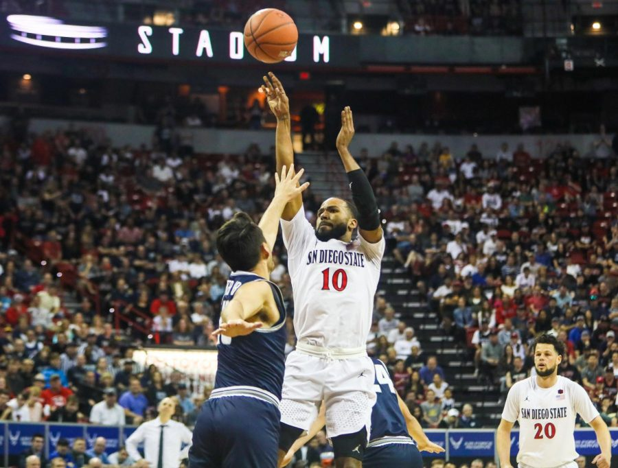 Then-senior guard KJ Feagin attempts a shot during the Aztecs' 59-56 loss against Utah State at the Thomas and Mack Center on March 7.