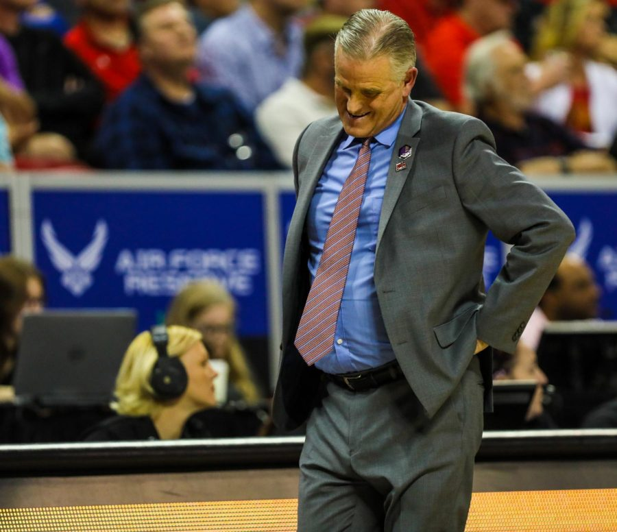 Head coach Brian Dutcher looks down in disappointment during the Aztecs' 59-56 loss against Utah State at Thomas and Mack Center on March 7.