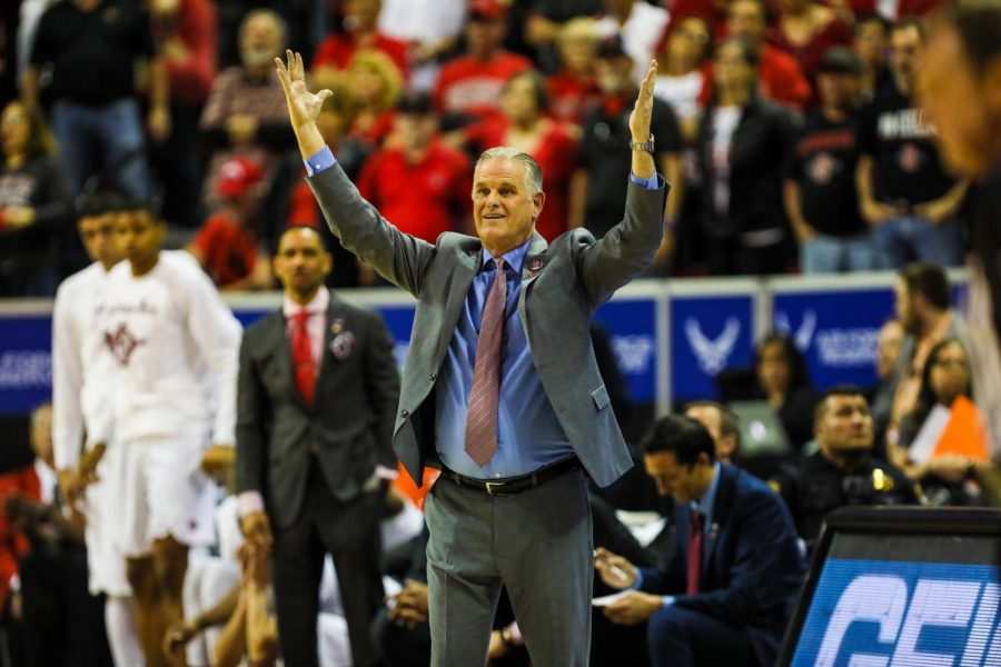 Head coach Brian Dutcher throws his hands up during the Aztecs' 59-56 loss against Utah State at Thomas and Mack Center on March 7.