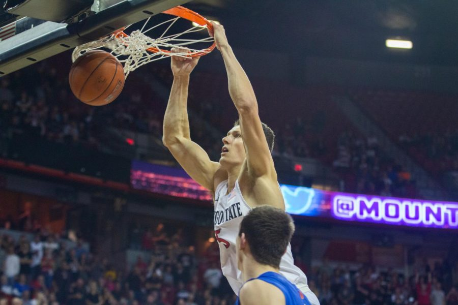 Senior forward Yanni Wetzell completes a slam dunk during the Aztecs' 81-68 win over Boise State on March 7 at the Thomas and Mack Center in Las Vegas.
