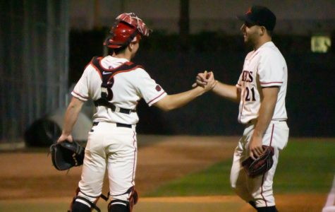 Sophomore catcher Wyatt Hendrie (left) and sophomore pitcher Brian Leonhardt (right) congratulate each other during the Aztecs' 4-1 win over Iowa on Feb. 21 at Tony Gwynn Stadium.