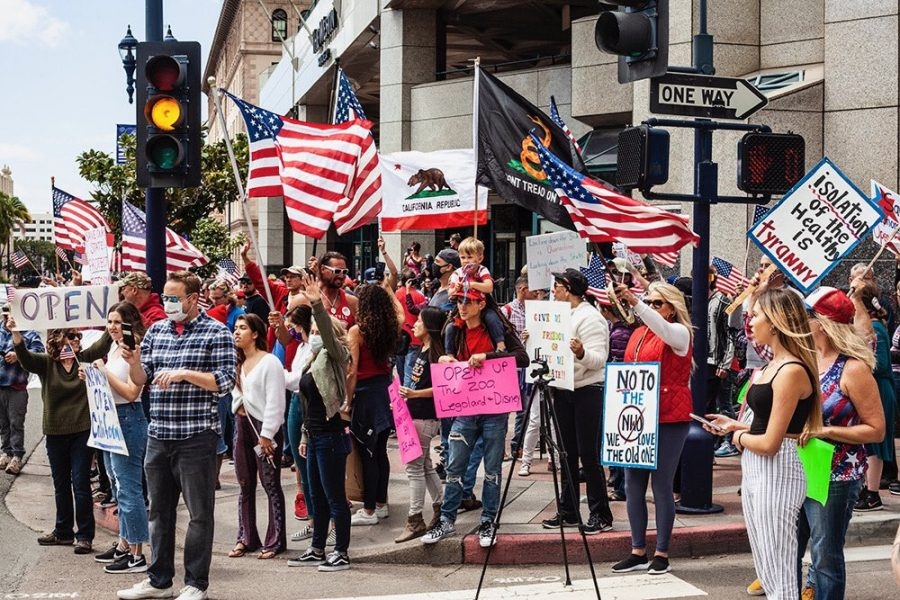 Protestors+gather+in+Downtown+San+Diego+in+opposition+to+California+Governor+Gavin+Newsom%27s+stay-at-home+order+on+April+18.+The+protest+persisted+despite+local+regulations+limiting+large+gatherings.