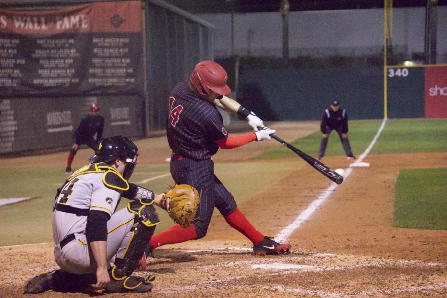 Senior outfielder Mike Jarvis connects on a pitch during the Aztecs' 4-1 win over Iowa on Feb. 21 at Tony Gwynn Stadium.