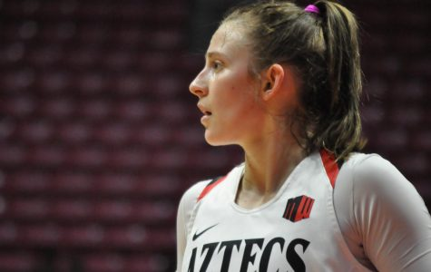 Then-senior guard Taylor Kalmer looks towards the court during the Aztecs' 75-74 win over New Mexico on Jan. 29 at Viejas Arena.