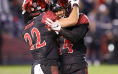Then-junior defensive back Tariq Thompson and then-junior running back Chase Jasmin celebrate after a play during SDSU's 13-3 victory over BYU on Nov. 30 at SDCCU Stadium.