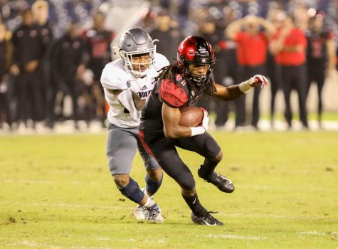 Then-sophomore wide receiver BJ Busbee attempts to escape a Nevada tackler during the Aztecs