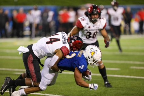 Fans will have to wait a few weeks longer to watch the San Diego State football team. That includes senior defensive back Tariq Thompson (pictured tackling a San José State player during the Aztecs