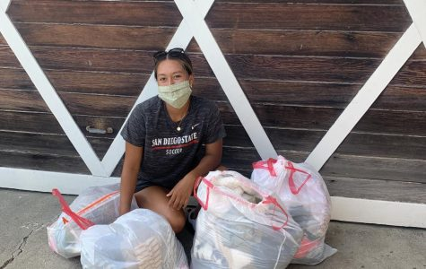 Women's soccer senior forward Veronica Avalos shown next to bags of clothes she donated to the nonprofit organization Unity 4 Orphans. Through the organization, the goods are delivered to children living in orphanages throughout Mexico and Latin America.