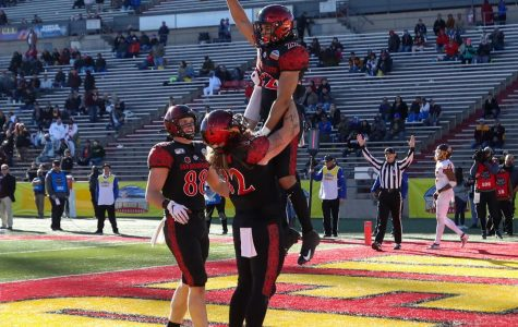 Then-junior running back Chase Jasmin celebrates in the end zone by holding the ball in the air after scoring a touchdown during the Aztecs' 48-11 win over Central Michigan on Dec. 21, 2019 at the New Mexico Bowl in Albuquerque, New Mexico.