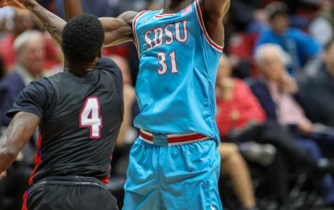 Then-sophomore forward Nathan Mensah attempts a one-handed shot over a Tennessee State defender during the Aztecs' 62-49 win over the Tigers on Nov. 25, 2019 at Viejas Arena.