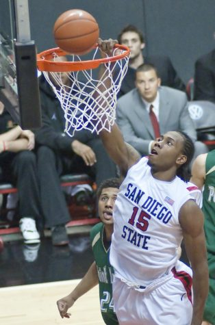 Former SDSU forward Kawhi Leonard dunks the ball during a preseason scrimmage agianst Point Loma Nazarene on Nov. 10, 2009.