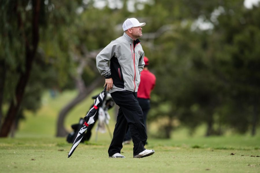 SDSU men's golf head coach Ryan Donovan walks the course during the Lamkin San Diego Classic on March 10 at San Diego Country Club in Chula Vista, Calif.