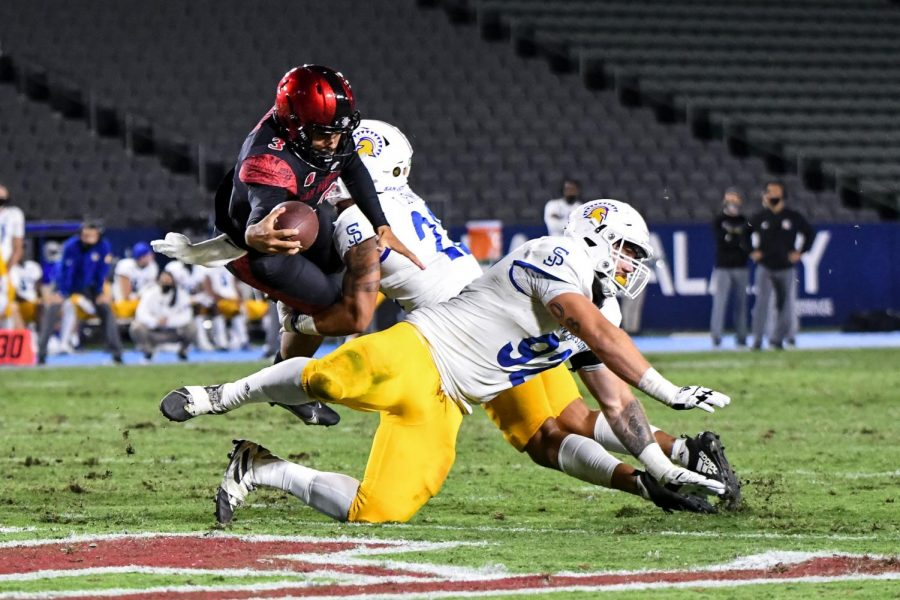 Sophomore quarterback Carson Baker elevates to score a 1-yard rushing touchdown during the Aztecs' 28-17 loss to San José State on Nov. 6 at Dignity Health Sports Park in Carson, Calif.