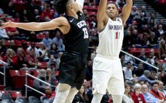 Then-junior forward Matt Mitchell fires a shot over a Grand Canyon defender during the Aztecs' 86-61 win over the Lopes on Nov. 13, 2019 at Viejas Arena.