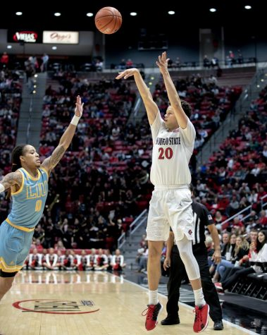 Then-junior guard Jordan Schakel shoots a 3-point shot over a Long Island defender during the Aztecs' 81-64 win over the Sharks on Nov. 22 at Viejas Arena.