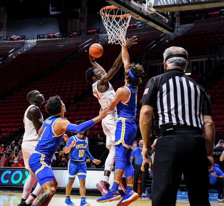 Junior forward Nathan Mensah goes up for a layup during the Aztecs' 73-58 win over UCLA on Nov. 25 at Viejas Arena.