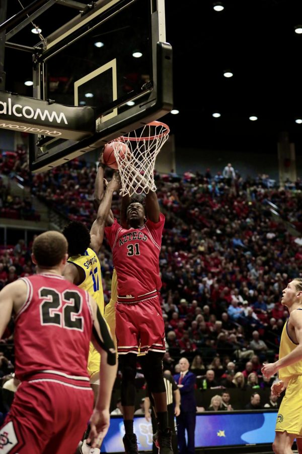 Then-sophomore forward  Nathan Mensah goes up to the basket during the Aztecs' 59-57 victory over San José State on Dec. 8, 2019 at Viejas Arena.