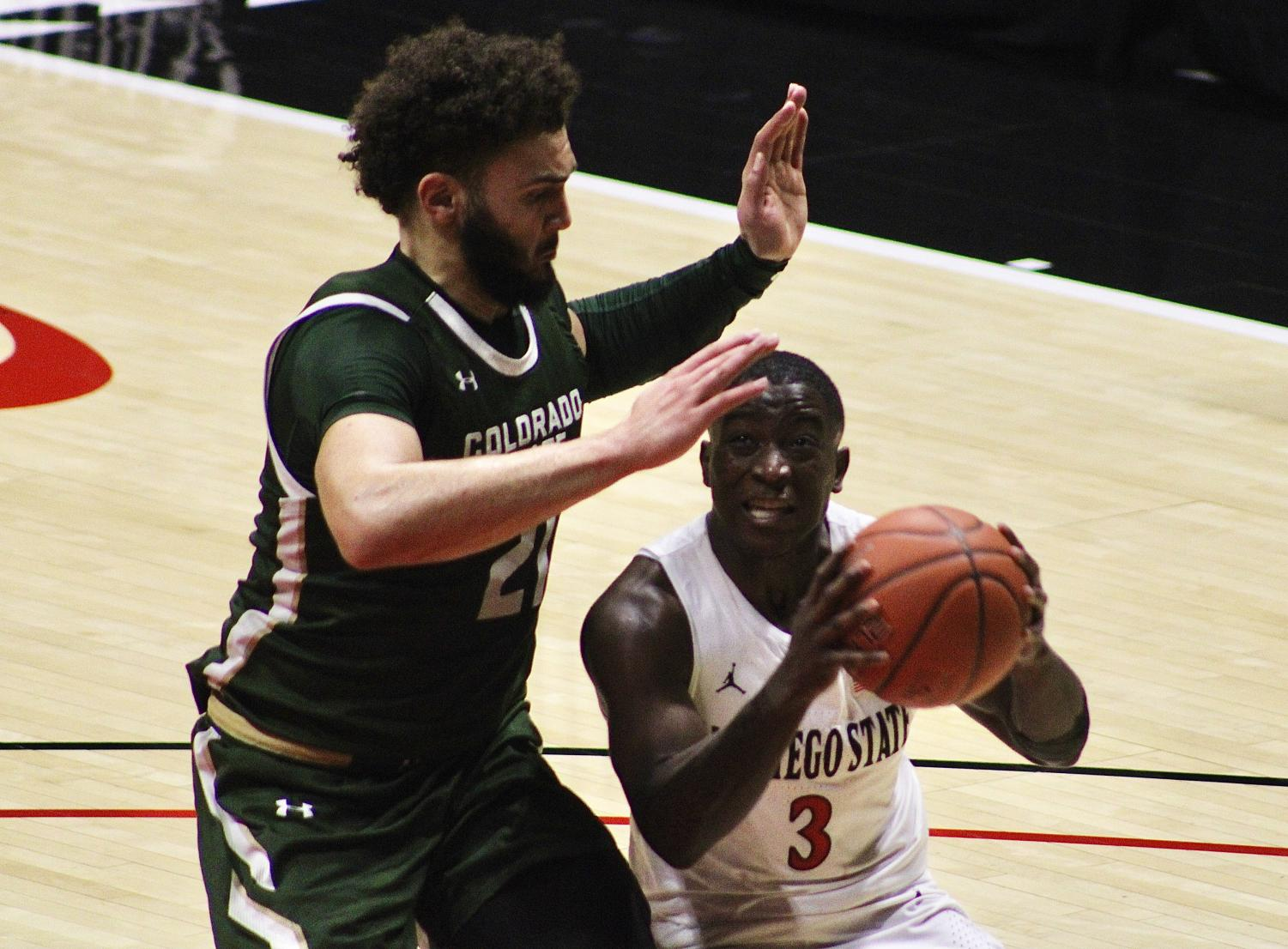 Senior guard Terrell Gomez looks to attempt a shot against Colorado State sophomore forward David Roddy during the Aztecs