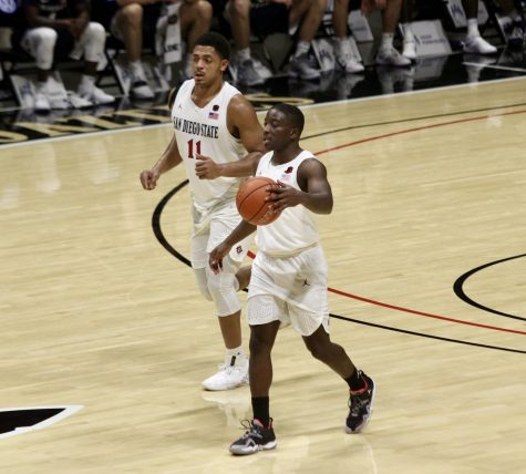 Senior guard Terrell Gomez (front) and senior forward Matt Mitchell run up the court during the Aztecs