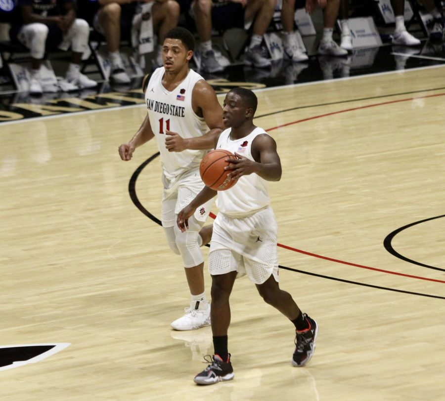 Senior guard Terrell Gomez (front) and senior forward Matt Mitchell run up the court during the Aztecs' 72-62 loss to Brigham Young on Dec. 18 at Viejas Arena. Mitchell scored a career-high 35 points in the losing effort.