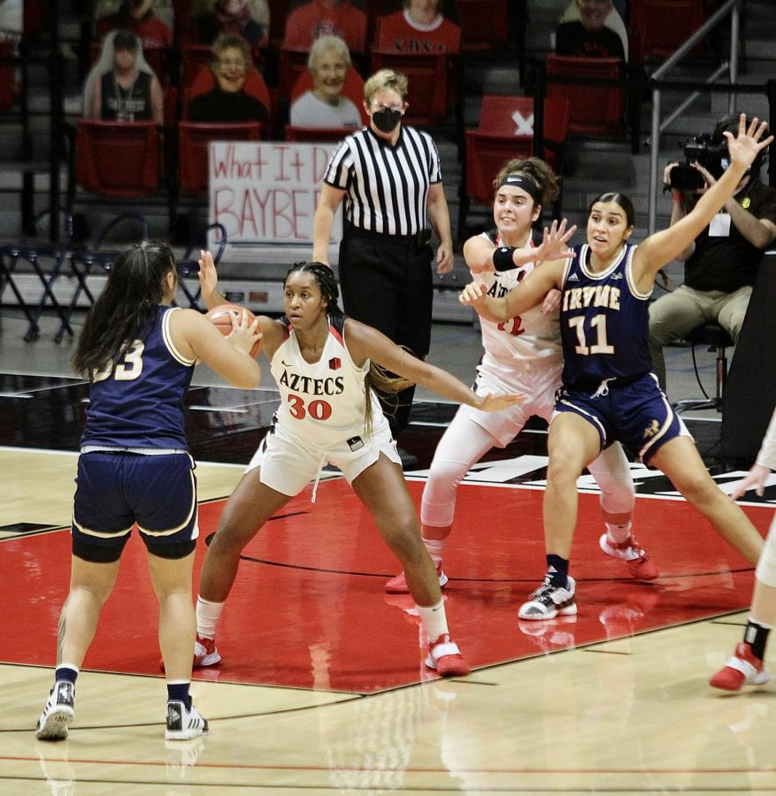 Junior forward Ivvana Murillo (#30 on the Aztecs) and freshman forward Flo Vinerte (right) defend two UC Irvine players during the Aztecs' 66-55 loss to the Anteaters on Dec. 19, 2020 at Viejas Arena.