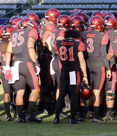 San Diego State football senior tight end Nolan Givan (#85), junior wide receiver Ethan Dedeaux (#81) and sophomore quarterback Carson Baker (#3) stand at the back of the Aztecs