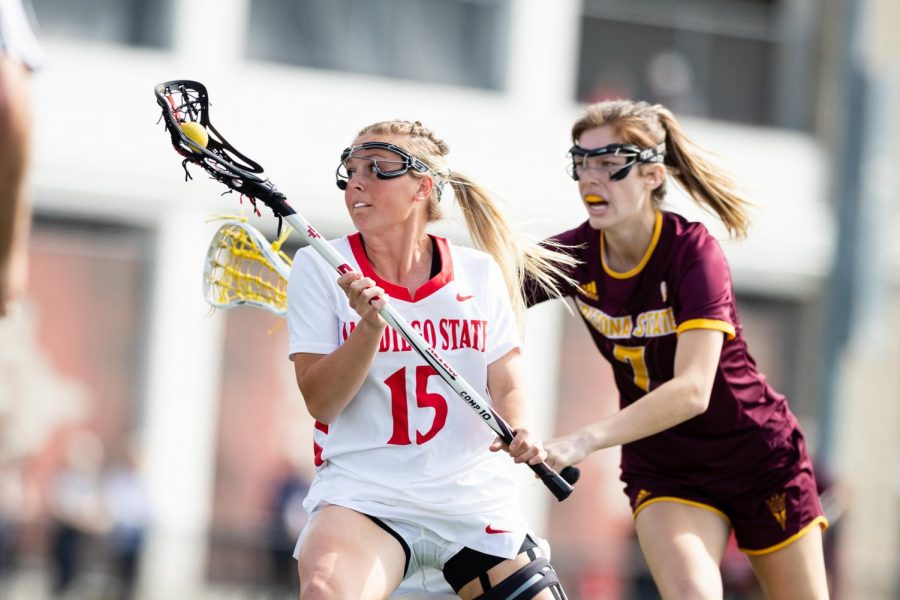 San Diego State lacrosse then-senior midfielder Taylor Sullivan looks to escape an Arizona State defender during the Aztecs' 19-18 win over the Sun Devils on Feb. 20, 2020 at Aztec Lacrosse Field.