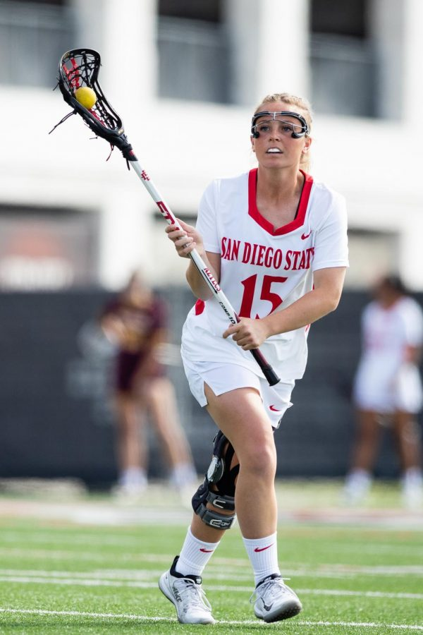 San Diego State lacrosse then-senior midfielder Taylor Sullivan carries the ball during the Aztecs' 19-18 win over the Sun Devils on Feb. 20, 2020 at Aztec Lacrosse Field.