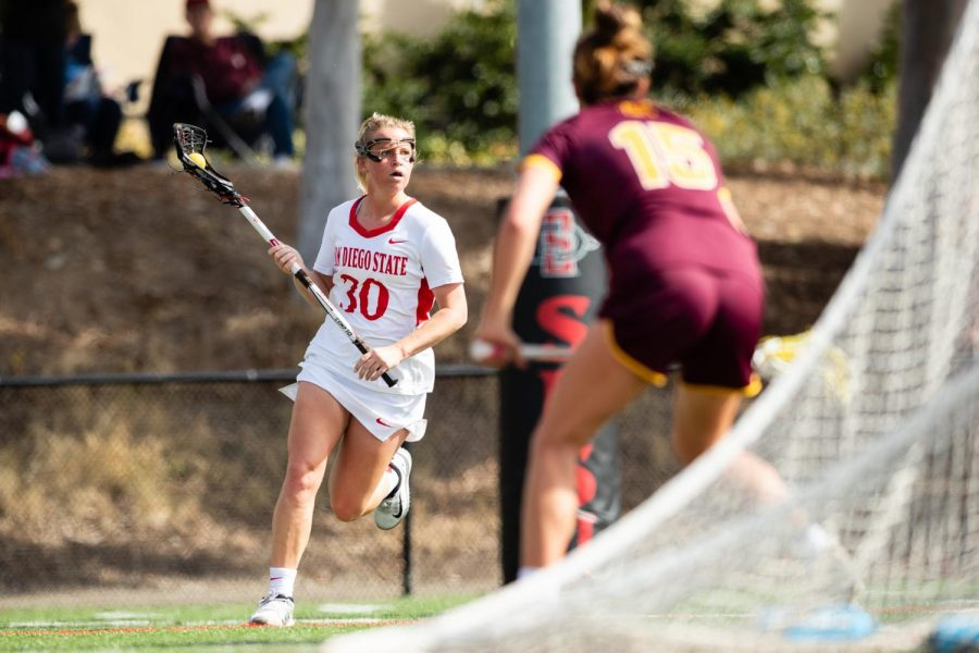 San Diego State then-junior midfielder Bailey Brown carries the ball upfield during the Aztecs' 19-18 win over Arizona State on Feb. 20, 2020 at Aztec Lacrosse Field.