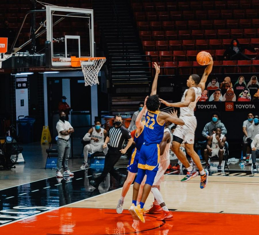 Sophomore forward Keshad Johnson elevates for a one-handed slam during the Aztecs' 85-54 win over San José State on Feb. 8 at Viejas Arena.