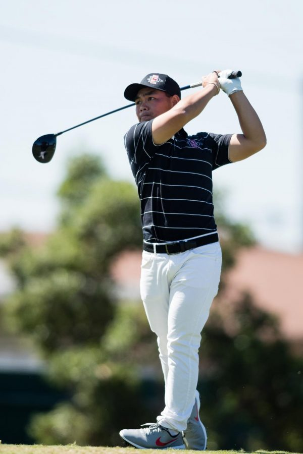 San Diego State men's golf senior Puwit Anupansuebsai swings his driver during the 2019-20 season.